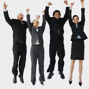 Front view portrait of four business executives jumping with arms raised --- Image by © Royalty-Free/Corbis