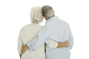 elderly-couple-hugging-from-behind